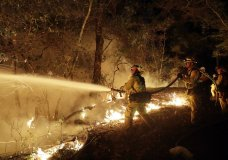 Fire crews battle a wildfire Saturday, Oct. 14, 2017, in Santa Rosa, Calif. (AP Photo/Marcio Jose Sanchez)