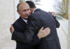 In this Monday, Nov. 20, 2017, photo, Russian President Vladimir Putin, left, embraces Syrian President Bashar Assad in the Bocharov Ruchei residence in the Black Sea resort of Sochi, Russia. Putin has met with Assad ahead of a summit between Russia, Turkey and Iran and a new round of Syria peace talks in Geneva, Russian and Syrian state media reported Tuesday. (Mikhail Klimentyev, Kremlin Pool Photo via AP)