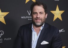 FILE - In this April 26, 2017 file photo, Brett Ratner arrives at the Wolfgang Puck's Post-Hollywood Walk of Fame Star Ceremony Celebration in Beverly Hills, Calif. Hollywood's widening sexual harassment crisis ensnared another prominent film director when six women, Including actress Olivia Munn, accused Ratner of harassment or misconduct in a Los Angeles Times report, on Wednesday, Nov. 1. (Photo by Willy Sanjuan/Invision/AP, File)