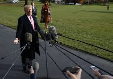 President Donald Trump speaks to reporters before leaving the White House, Tuesday, Nov. 21, 2017, in Washington for a Thanksgiving trip to Mar-a-Lago estate in Palm Beach, Fla., as first lady Melania Trump and their son Barron wait. (AP Photo/Evan Vucci)