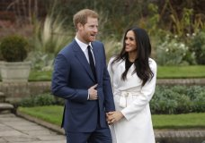 Britain's Prince Harry and his fiancee Meghan Markle pose for photographers during a photocall in the grounds of Kensington Palace in London, Monday Nov. 27, 2017. Britain's royal palace says Prince Harry and actress Meghan Markle are engaged and will marry in the spring of 2018. (AP Photo/Matt Dunham)
