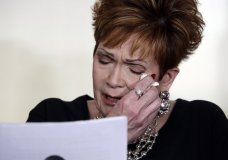 """Beverly Young Nelson, the latest accuser of Alabama Republican Roy Moore, reads her statement at a news conference, in New York, Monday, Nov. 13, 2017. Nelson says Moore assaulted her when she was 16 and he offered her a ride home from a restaurant where she worked. Moore says the latest allegations against him are a """"witch hunt."""" (AP Photo/Richard Drew)"""