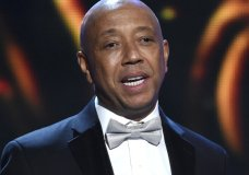 FILE - In this Feb. 6, 2015, file photo, hip-hop mogul Russell Simmons presents the Vanguard Award on stage at the 46th NAACP Image Awards in Pasadena, Calif. Simmons announced on Nov. 30, 2017, he would be stepping down from companies he founded following a new allegation of sexual misconduct. (Photo by Chris Pizzello/Invision/AP, File)
