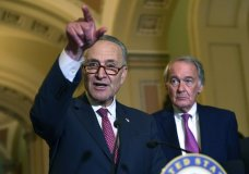 Senate Minority Leader Sen. Chuck Schumer of N.Y., left, standing with Sen. Edward Markey, D-Mass., right, speaks to reporters following the weekly Democratic policy luncheon on Capitol Hill in Washington, Tuesday, Oct. 31, 2017. (AP Photo/Susan Walsh)