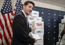 Speaker of the House Paul Ryan, R-Wis., points to boxes of petitions supporting the Republican tax reform bill that is set for a vote later this week as he arrives for a news conference on Capitol Hill in Washington, Tuesday, Nov. 14, 2017. (AP Photo/J. Scott Applewhite)