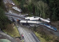Cars from an Amtrak train that derailed lie spilled onto Interstate 5, Monday, Dec. 18, 2017, in DuPont, Wash. The Amtrak train making the first-ever run along a faster new route hurtled off the overpass Monday near Tacoma and spilled some of its cars onto the highway below, killing several people, authorities said. (Bettina Hansen/The Seattle Times via AP)