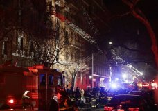 Firefighters respond to a building fire Thursday, Dec. 28, 2017, in the Bronx borough of New York. The Fire Department of New York says a blaze raging in the Bronx apartment building has seriously injured more than a dozen of people. (AP Photo/Frank Franklin II)