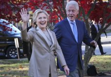 FILE - In this Nov. 8, 2016, file photo, then-Democratic presidential candidate Hillary Clinton, and her husband former President Bill Clinton, greet supporters after voting in Chappaqua, N.Y. The FBI is investigating allegations of corruption connected to the Clinton Foundation while Hillary Clinton was secretary of state. That's according to a person familiar with the investigation who spoke on condition of anonymity to discuss it. (AP Photo/Seth Wenig, File)