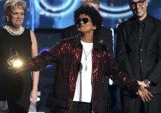 "Bruno Mars accepts the award for record of the year for ""24K Magic"" at the 60th annual Grammy Awards at Madison Square Garden on Sunday, Jan. 28, 2018, in New York. (Photo by Matt Sayles/Invision/AP)"