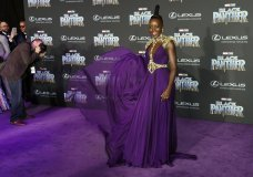 "Lupita Nyong'o, a cast member in ""Black Panther,"" shows off her dress for photographers at the premiere of the film at The Dolby Theatre on Monday, Jan. 29, 2018, in Los Angeles. (Photo by Chris Pizzello/Invision/AP)"
