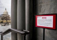 The dome of the Capitol Building is visible at left of a closure sign that is posted outside of the Library of Congress during a government shutdown in Washington, Monday, Jan. 22, 2018. (AP Photo/Andrew Harnik)