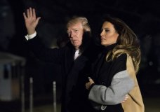 President Donald Trump with first lady Melania Trump waves as he returns to the White House in Washington, Monday, Jan. 15, 2018. Trump spent the holiday weekend at his Mar-a-Lago estate in Palm Beach, Fla. (AP Photo/Manuel Balce Ceneta)