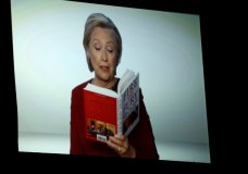"Hillary Clinton appears on screen reading an excerpt from the book ""Fire and Fury"" during a skit at the 60th annual Grammy Awards at Madison Square Garden on Sunday, Jan. 28, 2018, in New York. (Photo by Matt Sayles/Invision/AP)"