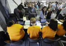 FILE - In this Wednesday, Aug. 2, 2017, file photo, job candidates are processed during a job fair at the Amazon fulfillment center in Robbinsville Township, N.J. On Friday, Jan. 5, 2018, the U.S. government issues the December jobs report. (AP Photo/Julio Cortez, File)