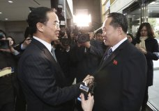 South Korean Unification Minister Cho Myoung-gyon, right, shakes hands with the head of North Korean delegation Ri Son Gwon before their meeting at the Panmunjom in the Demilitarized Zone in Paju, South Korea, Tuesday, Jan. 9, 2018. South Korean media said North and South Korea have begun talks at their border about how to cooperate in next month's Winter Olympics and how to improve their long-strained ties. (Korea Pool/Yonhap via AP)