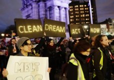 Protestors gather at Grand Army Plaza near the home of Sen. Charles Schumer, D-N.Y Tuesday, Jan. 23, 2018, in the Brooklyn borough of New York. (AP Photo/Frank Franklin II)