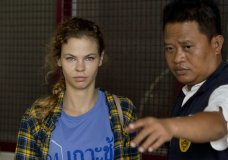 A police officer escorts Anastasia Vashukevich from a detention center in Pattaya, south of Bangkok, Thailand, Wednesday, Feb. 28, 2018, after she was arrested Sunday in the Thai resort city of Pattaya while giving sex lessons to Russian tourists. Vashukevich told The Associated Press from a police van Wednesday that she fears for her life, and wants to exchange information on alleged Russian ties to U.S. President Donald Trump's campaign for her own personal safety. (AP Photo/Gemunu Amarasinghe)