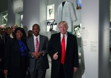 FILE - In this Feb. 21, 2017 file photo, President Donald Trump gives a thumbs up during a tour of the National Museum of African American History and Culture with Housing and Urban Development Secretary-designate Dr. Ben Carson and his wife Candy Carson in Washington. A poll shows just over half of Americans think that black people face hurdles to progress in the United States. The new poll by The Associated Press-NORC Center for Public Affairs Research released Wednesday, Feb. 28, 2018, also found that nearly half, including three-quarters of African Americans themselves, think President Donald Trump's policies are making matters worse. (AP Photo/Evan Vucci, File)