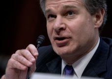 FBI Director Christopher Wray speaks during a Senate Select Committee on Intelligence hearing on worldwide threats, Tuesday, Feb. 13, 2018, in Washington. Wray said the agency provided the White House with information twice last year about Rob Porter, the top Trump aide who resigned as staff secretary last week after domestic violence allegations from two ex-wives became public. Wray said the bureau closed its background investigation on Porter in January, weeks before the allegations were published. (AP Photo/Andrew Harnik)
