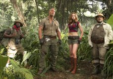 """FILE - This file image released by Sony Pictures shows Kevin Hart, from left, Dwayne Johnson, Karen Gillan and Jack Black in """"Jumanji: Welcome to the Jungle."""" According to studio estimates Sunday, """"Jumanji"""" grossed $11 million over the weekend. (Frank Masi/Sony Pictures via AP, File)"""