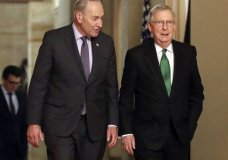 Senate Majority Leader Mitch McConnell, R-Ky., and Senate Minority Leader Chuck Schumer, D-N.Y., left, walk to the chamber after collaborating on an agreement in the Senate on a two-year, almost $400 billion budget deal that would provide Pentagon and domestic programs with huge spending increases, at the Capitol in Washington, Wednesday, Feb. 7, 2018.(AP Photo/Pablo Martinez Monsivais)