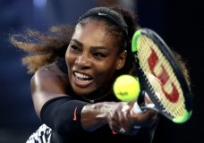FILE - In this Jan. 28, 2017, file photo, Serena Williams makes a backhand return to her sister Venus during the women's singles final at the Australian Open tennis championships in Melbourne, Australia. Five months after becoming a mother, Serena Williams is ready to return to competitive tennis for the first time since her 2017 Australian Open title. Williams will join her sister Venus in helping the United States begin its Fed Cup title defense Saturday, Feb. 10, 2018, against the Netherlands. (AP Photo/Aaron Favila, File)