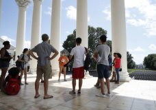 FILE - In this Aug. 18, 2017 file photo, first year students tour the University of Virginia in Charlottesville, Va., a week after a white nationalist rally took place on campus. A group that monitors extremism in the U.S. says white supremacists brought their messages to college campuses in a surging number of cases last school year. (AP Photo/Jacquelyn Martin)