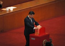 Chinese President Xi Jinping casts his vote for an amendment to China's constitution that will abolish term limits on the presidency and enable him to rule indefinitely, during a plenary session of the National People's Congress at the Great Hall of the People in Beijing, Sunday, March 11, 2018. (AP Photo/Andy Wong)