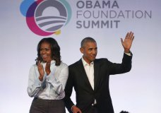 FILE - In this Oct. 13, 2017 file photo, former President Barack Obama, right, and former first lady Michelle Obama arrive for the first session of the Obama Foundation Summit in Chicago. Barack Obama and Netflix reportedly are negotiating a deal for the former president and his wife, Michelle, to produce shows exclusively for the streaming service. The proposed deal was reported Friday, March 9, 2018, by The New York Times, which cited people familiar with the discussions who were not identified. (AP Photo/Charles Rex Arbogast, File)