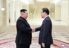 """In this Monday, March 5, 2018 photo, provided by the North Korean government on March 6, North Korean leader Kim Jong Un, left, shakes hands with South Korean National Security Director Chung Eui-yong in Pyongyang, North Korea. Independent journalists were not given access to cover the event depicted in this image distributed by the North Korean government. The content of this image is as provided and cannot be independently verified. Korean language watermark on image as provided by source reads: """"KCNA"""" which is the abbreviation for Korean Central News Agency. (Korean Central News Agency/Korea News Service via AP)"""