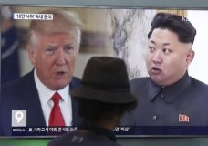 "FILE - In this Aug. 10, 2017, file photo, a man watches a television screen showing U.S. President Donald Trump and North Korean leader Kim Jong Un during a news program at the Seoul Train Station in Seoul, South Korea. South Korea's national security director says President Donald Trump has decided he will meet with North Korea's Kim Jong Un ""by May."" Chung Eui-yong spoke outside the White House, Thursday, March 8, 2018, after a day of briefings with senior U.S. officials, including Trump, on the recent inter-Korea talks. Chung says Trump said ""he would meet Kim Jong Un by May to achieve permanent denuclearization"" of the Korean peninsula. (AP Photo/Ahn Young-joon, File)"