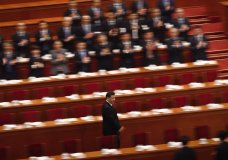 Delegates applaud as President Xi Jinping arrives for a plenary session of China's National People's Congress (NPC) at the Great Hall of the People in Beijing on Tuesday, March 13, 2018. On Sunday, China's legislature scrapped a two-term limit on the presidency, paving the way for Xi to rule for as long as he wants. (AP Photo/Andy Wong, File)
