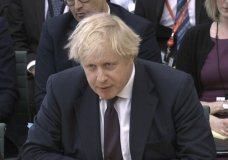 "In this image taken from video Britain's Foreign Secretary Boris Johnson gives evidence to the House of Commons Foreign Affairs Committee in Portcullis House, London Wednesday March 21, 2018. Johnson said Russia carried out a nerve-agent attack on British soil because the U.K. has ""time and again called out Russia over its abuses"" of human rights and democratic values. (PA via AP)"