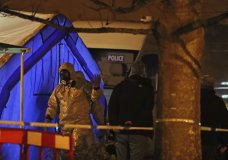"""Investigators next to a police tent outside The Mill public house at the Maltings in Salisbury, England, Tuesday, March 6, 2018, near to where former Russian double agent Sergei Skripal was found critically ill. Britain's counterterrorism police took over an investigation Tuesday into the mysterious collapse of a former spy and his daughter, now fighting for their lives. The government pledged a """"robust"""" response if suspicions of Russian state involvement are proven. Sergei Skripal and his daughter are in a critical condition after collapsing in the English city of Salisbury on Sunday. (Steve Parsons/PA via AP)"""