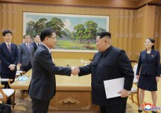 """In this Monday, March 5, 2018 photo, provided by the North Korean government on March 6, North Korean leader Kim Jong Un, front right, shakes hands with South Korean National Security Director Chung Eui-yong after Chung gave Kim the letter from South Korean President Moon Jae-in, in Pyongyang, North Korea. Independent journalists were not given access to cover the event depicted in this image distributed by the North Korean government. The content of this image is as provided and cannot be independently verified. Korean language watermark on image as provided by source reads: """"KCNA"""" which is the abbreviation for Korean Central News Agency. (Korean Central News Agency/Korea News Service via AP)"""