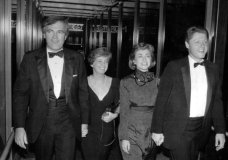"""FILE - In this Oct. 12, 1988 file photo, Vince Foster, left, walks with his wife and then Gov. Bill Clinton and his wife Hillary Rodham Clinton, in Little Rock, Ark. No new autopsy was performed on former White House deputy counsel Vince Foster at a U.S. Navy hospital in Virginia, despite the claim of an online story that experts there found evidence of a homicide. The story from usapoliticstoday claimed Foster's body was exhumed and examined at """"the Naval Hospital in Norfolk, Virginia."""" The article also alleged there was no autopsy when Foster died in 1993. (The Northwest Arkansas Democrat-Gazette via AP, File)"""