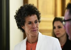 Andrea Constand walks while breaking for lunch during Bill Cosby's sexual assault trial at the Montgomery County Courthouse, Friday, April 13, 2018, in Norristown, Pa. Constand, Cosby's chief accuser, took the witness stand Friday. (AP Photo/Corey Perrine, Pool)