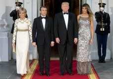 President Donald Trump, first lady Melania Trump, French President Emmanuel Macron and his wife Brigitte Macron, pose for photographs as they arrive for a State Dinner at the White House in Washington, Tuesday, April 24, 2018. (AP Photo/Andrew Harnik)