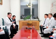 """In this Monday, April 23, 2018, photo provided Tuesday, April 24, 2018, by the North Korean government, North Korean leader Kim Jong Un, left, meets China's ambassador to North Korea Li Jinjun, second from right, at the hospital where injured Chinese tourists are treated, in North Korea. A traffic accident in North Korea has killed 32 Chinese tourists and four North Koreans, Chinese officials said Monday. Independent journalists were not given access to cover the event depicted in this image distributed by the North Korean government. The content of this image is as provided and cannot be independently verified. Korean language watermark on image as provided by source reads: """"KCNA"""" which is the abbreviation for Korean Central News Agency. (Korean Central News Agency/Korea News Service via AP)"""