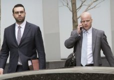 Michael Cohen's attorneys Todd Harrison, right, and Joseph Evans arrive at Federal court, Friday, April 13, 2018, in New York. A hearing has been scheduled before U.S. District Judge Kimba Wood to address Cohen's request for a temporary restraining order related to the judicial warrant that authorized a search of his Manhattan office, apartment and hotel room this week. (AP Photo/Mary Altaffer)