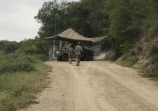National Guard troops guard the border in Roma, Texas, on Tuesday, April 10, 2018. The deployment of National Guard members to the U.S.-Mexico border at President Donald Trump's request was underway Tuesday with a gradual ramp-up of troops under orders to help curb the flow of illegal immigration. (Verónica G. Cárdenas via AP)