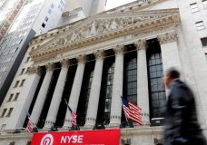 In this April 5, 2018, photo, a pedestrian passes the New York Stock Exchange. The U.S. stock market opens at 9:30 a.m. EDT on Wednesday, April 11. (AP Photo/Richard Drew)