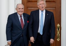 FILE - In this Nov. 20, 2016, file photo, then-President-elect Donald Trump, right, and former New York Mayor Rudy Giuliani pose for photographs as Giuliani arrives at the Trump National Golf Club Bedminster clubhouse in Bedminster, N.J. Giuliani is joining the legal team defending President Donald Trump in the special counsel's Russia investigation. That's according to a statement from Trump personal attorney Jay Sekulow. (AP Photo/Carolyn Kaster, File)