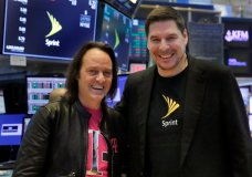 T-Mobile CEO John Legere, left, and Sprint CEO Marcelo Claure pose for photos on the floor of the New York Stock Exchange, Monday, April 30, 2018. To gain approval for their $26.5 billion merger agreement, T-Mobile and Sprint aim to convince antitrust regulators that there is plenty of competition for wireless service beyond Verizon and AT&T. (AP Photo/Richard Drew)