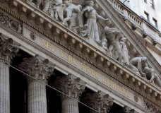 FILE- This April 5, 2018, file photo shows the facade of the New York Stock Exchange. The U.S. stock market opens at 9:30 a.m. EDT on Tuesday, April 25. (AP Photo/Richard Drew, File)