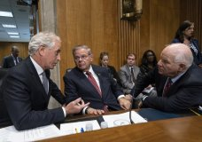 From left, Senate Foreign Relations Committee Chairman Bob Corker, R-Tenn., and Sen. Bob Menendez, D-N.J., the ranking member, and Sen. Ben Cardin, D-Md., confer before the vote on President Donald Trump's nominee for secretary of state, Mike Pompeo, who has faced considerable opposition before the panel, on Capitol Hill in Washington, Monday, April 23, 2018. (AP Photo/J. Scott Applewhite)