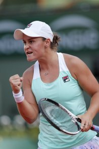 Australia's Ashleigh Barty clenches her fist after winning the first set against Serena Williams of the U.S. during their second round match of the French Open tennis tournament at the Roland Garros stadium in Paris, France, Thursday, May 31, 2018. (AP Photo/Thibault Camus)