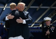 President Donald Trump embraces the last graduate in line during a graduation and commissioning ceremony at the U.S. Naval Academy, Friday, May 25, 2018, in Annapolis, Md. (AP Photo/Evan Vucci)