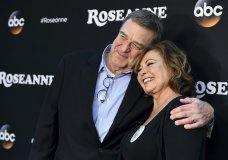 "FILE - In this March 23, 2018 file photo, John Goodman, left, and Roseanne Barr arrive at the Los Angeles premiere of ""Roseanne"" in Burbank, Calif. ABC has cancelled its hit reboot of ""Roseanne"" following her racially insensitive tweet about former Obama adviser Valerie Jarrett, Tuesday, May 29. ABC Entertainment President Channing Dungey said the comment ""is abhorrent, repugnant and inconsisten with our values, and we have decided to cancel the show."" (Photo by Jordan Strauss/Invision/AP, File)"