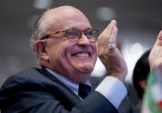 Rudy Giuliani, an attorney for President Donald Trump, applauds at the Iran Freedom Convention for Human Rights and democracy at the Grand Hyatt, Saturday, May 5, 2018, in Washington. (AP Photo/Andrew Harnik)